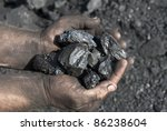 Hands Of The Miner With Coal