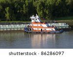 Tug boat and chemical barge on the Mississippi river - stock photo