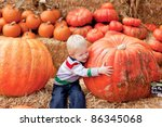 Adorable Toddler Is Hugging A...