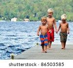 Three Brothers Walk Along The...