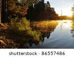 Calm Lake Reflection In Sunrise