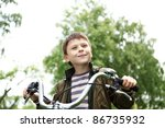 happy smiling boy on a bicycle... | Shutterstock . vector #86735932