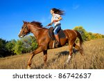 Stock photo beautiful girl riding a horse in countryside 86742637