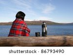 Woman by a lake - stock photo