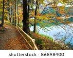 Stock photo mountain synevir lake view through autumn tree twigs 86898400