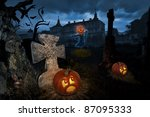 Jack-o-lantern come alive in a cemetery near old castle - stock photo