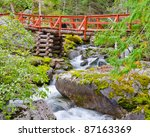 Red Bridge And Mountain River...