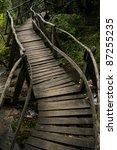Winding Wooden Bridge Over A...