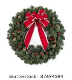 Christmas wreath with red bow on white background - stock photo
