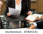 Small photo of Mature female lawyer or notary with client in her office for counseling