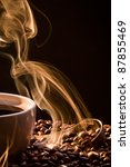 Dry coffee with golden smoke - stock photo