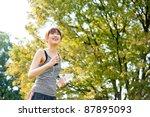 attractive asian woman running... | Shutterstock . vector #87895093