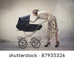 young mother cuddling her baby... | Shutterstock . vector #87935326