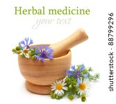 Herbal medicine and treatment - camomile, cornflowers, mortar on white background - stock photo