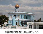 Ornate Cuban building in Cienfuegos with tower - stock photo