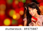 Smiling woman with a gift in her hands - stock photo