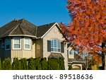 Small photo of Luxury big house in the autumn time with the tree afore with the red leafs in Vancouver