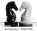 confrontation of chess pieces isolated on a white background - stock photo