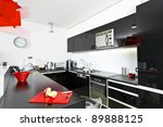 Moder black and white kitchen interior with red lamp - stock photo