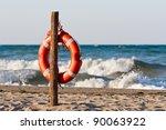 Lifebuoy On The Sandy Beach