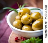 Green Olives In A White Dish