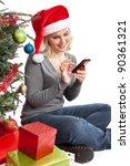 Woman Wearing Santa Hat Next T...