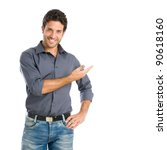 Small photo of Happy smiling young man presenting and showing your text or product isolated on white background