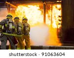 Several firefighters go offensive for a fire attack. - stock photo