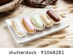 Group of french dessert eclair on the white plate - stock photo