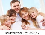 a young friendly family looking ...   Shutterstock . vector #91076147