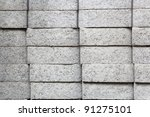 Four stacks of Gray rectangular pavers at a hardware store - stock photo