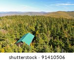 A View Of A Cabin From The...