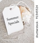 Summer Sales Tag on Sand with Shell - stock photo