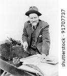 Small photo of Bookkeeper with adding machine and pencil in his mouth