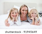 mother embracing her children... | Shutterstock . vector #91945649