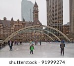 Stock photo toronto canada dec locals and visitors skate on nathan phillips square outdoor rink in 91999274