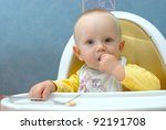 baby boy eating in a chair with ... | Shutterstock . vector #92191708