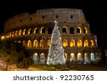 Coliseum And Christmas Tree In...