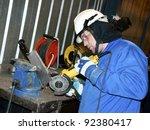 worker sharpen a knife | Shutterstock . vector #92380417