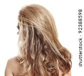long healthy loose blond hair styled with volume - view from the back on white background - stock photo