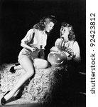 two women sitting on a bale of... | Shutterstock . vector #92423812