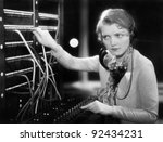 Young Woman Working As A...