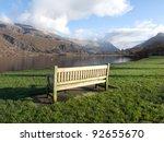 a wooden bench on green grass...