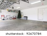 Small photo of An almost empty garage to be used as storage for junk that will be collected over the years