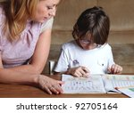 mother helps her son to do... | Shutterstock . vector #92705164