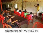 KO CHANG, THAILAND - JANUARY 6: Unknown children in lesson at school by project Cambodian Kids Care to help deprived children in deprived areas with education, on January 6, 2012 in Ko Chang, Thailand - stock photo