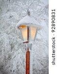 Bright Shining Snowy Street Lamp