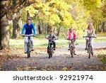 family on bikes in the park | Shutterstock . vector #92921974