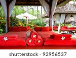 spa massage bed with red towels.... | Shutterstock . vector #92956537