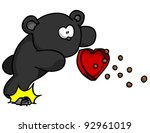 Black bear tripping while carrying box of candy - stock photo